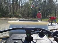Driving cement a small load at a time to protect the yard while installing basketball court foundation in Agawam, MA.