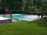 Backyard basketball surface, hoops, lights, and rebound fence in Pembroke, MA. We sport basketball and other courts that can be yours in Boston, Dighton, Westport, Swansea, Watertown or Acushnet.