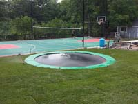 We installed the in-ground trampoline in the foreground, along with the background court for various sports like basketball, volleyball and tennis, and the finish sod and landscaping touches. Durable sport surfaces like this could be yours, from the city to villages like Craigville, Bryantville, Monponsett, Elmwood, or Pleasant Lake.