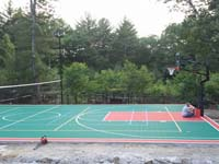 Backyard basketball court in Pembroke, MA. Whatever your sport, you could have a court surface and accessories of your own in Bolton, Berlin, Harvard, Littleton or Ayer.