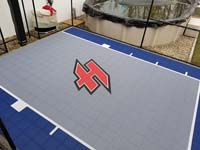 Small blue and grey basketball court in Braintree, MA, featuring a custom red H logo.