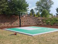 Backyard basketball court in Bridgewater, MA. We could install backyard basketball for you, too, in nearby Rhode Island locations like Middletown, Jamestown, Johnston, Cranston, Tiverton, and Woonsocket.