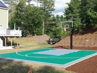 Backyard basketball court in Pembroke, MA. Whatever your sport, you could have a court surface and accessories of your own in Millis, Falmouth, Holbrook, Foxborough or East Freetown.