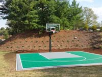 Backyard basketball court in Bridgewater, MA. Whatever your sport, you could have a court surface and accessories of your own in Norton, Westwood, Walpole, Cohasset or Needham.