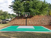 Backyard basketball court in Bridgewater, MA. Whatever Bridgewater you're in, we can make your backyard volleyball, tennis or basketball dreams happen. West Bridgewater, East Bridgewater, North Bridgewater AKA Brockton? Call Basketball Courts of Massachusetts today.
