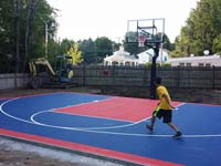 Backyard basketball court in Canton, MA. Whatever your sport, you could have a court surface and accessories of your own in Grafton, Truro, Wellfleet, Eastham or Manchester-by-the-Sea.