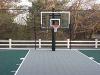 Backyard basketball court in Plymouth, MA. We could construct backyard basketball for you, too, in Sandwich, Bourne, Manoment, Cedarville, Duxbury or Osterville.