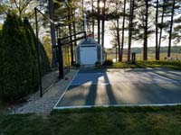 Backyard basketball court in Duxbury, MA A variety of games and court accessories are available.