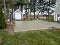 Backyard basketball court in Duxbury, MA. We can build your dream court in a wide range of sizes. You might be surprised where one can fit into your yard.