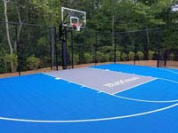 Blue and gray residential basketball court in Easton, MA.