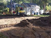 Excavation for backyard basketball court in Hanover, MA.