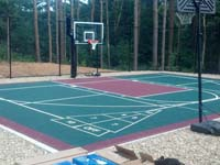 Backyard basketball court in Kingston, MA. Whatever your sport, you could have a court surface and accessories of your own.