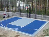 Basketball court with rebounder on quality concrete base in Kingston, MA