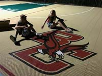Closeup of happy kids and custom BC Eagles logo on tan and green basketball court in Londonderry, NH.