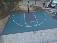 Backyard basketball court in Marion, MA.