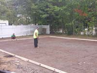 Backyard basketball court construction in Natick, MA.