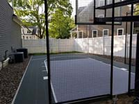 Slate green and titanium silver/grey basketball court in Needham, MA.