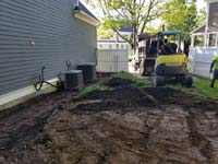 Removing grass and topsoil into truck/ shown below, part of preparing the way for a slate green and titanium silver/grey basketball court in Needham, MA.