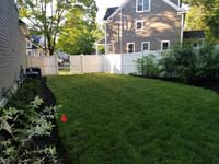 View toward fromt of most of side yard lawn to be replaced by slate green and titanium silver/grey basketball court in Needham, MA.