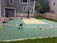 Basketball court in Needham, MA, shown after followup landscaping.