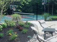 Backyard basketball court in Kingston, MA.