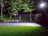Backyard basketball court with lights for night play in Massachusetts. This could be in Boxborough, Belmont, Sharon, Holliston, Arlington, or a happy backyard in your neighborhood.