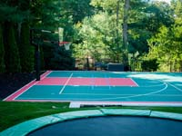 Backyard basketball court in Pembroke, MA.