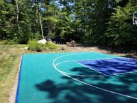 Jade green and blue Versacourt basketball tile on blacktop court in Rehoboth, MA.