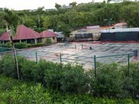 Old, worn Caribbean tennis court before restoration at Sandals Grande Antigua Resort and Spa in St. Johns, Antigua.