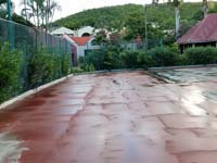 Before Caribbean tennis court restoration at Sandals Grande Antigua Resort and Spa in St. Johns, Antigua.