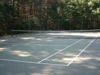 Before large commercial tennis court and multicourt facelift in Duxbury, MA. This could easily be your apartment or condo complex sport and game court in eastern Massachusetts being revitalized.