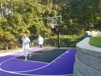 Backyard basketball court in Stoneham, MA.