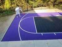 Backyard basketball court in Stoneham, MA. Whatever your sport, you could have a court surface and accessories of your own.