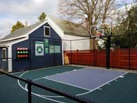 Backyard basketball court is the sort of thing you might find in Wakefield, MA or a yard like yours. Included are customer embellishments to their court area, with basketball rack, Celtics banners, and Larry Bird shirt.
