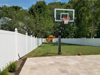 Basketball hoop system installed with a patio in Winchester, MA.