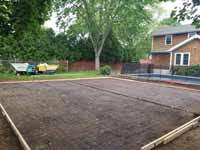 Shown here after ground prepped and with form underway for cement pour, Rhode Island backyard basketball court on concrete base in Barrington.