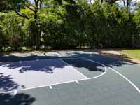 Rhode Island backyard basketball court on concrete base in Barrington. Shown here before any court upgrade work, old asphalt.
