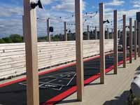 Black and red rooftop shuffleboard court in Boston, MA.