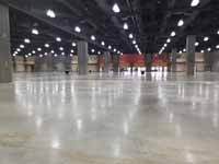 Versacourt indoor sport tile volleyball courts in convention center for New England Regional Volleyball Association (NERVA) Winterfest 2020 tournament in Hartford, CT. Large section of convention center showing blank slate before courts were in.