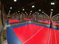 Versacourt indoor game tile volleyball courts in convention center for New England Regional Volleyball Association (NERVA) Winterfest 2020 tournament in Hartford, CT. Some of the completed courts shown here.