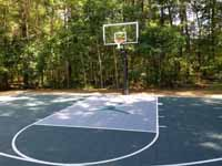 Slate green and titanium residential  basketball court with Michael Jordan custom logo in Duxbury, MA.