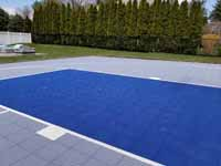 Titanium and navy blue residential basketball court in Hanson, MA.
