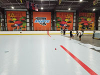 We traveled to Kapolei, Hawaii and inside to resurface two inline skate hockey rinks with Versacourt Speed Indoor tile. This is a picture of the work being done near the center of the first court, only partially completed.