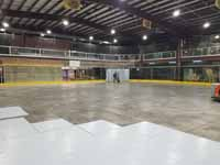 We traveled to Kapolei, Hawaii and inside to resurface two inline skate hockey rinks with Versacourt Speed Indoor tile. This is a picture of one corner of the court under construction, showing materials being staged for the next phase.