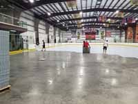 We traveled to Kapolei, Hawaii and inside to resurface two inline skate hockey rinks with Versacourt Speed Indoor tile. This shows inline tile installation perhaps halfay complete, in progress on the first rink.