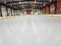 We traveled to Kapolei, Hawaii and inside to resurface two inline skate hockey rinks with Versacourt Speed Indoor tile. This is a view of most of the first court after surface is installed but before lines have been fully applied.