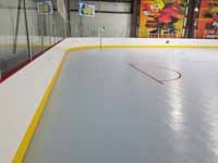 We traveled to Kapolei, Hawaii and inside to resurface two inline skate hockey rinks with Versacourt Speed Indoor tile. This is a view across part of one end of the completed rink, looking at the goal lines.