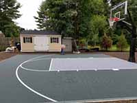 Home backyard basketball court in slate green and titanium colors in Lexington, MA.