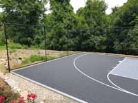Charcoal and titanium Cape Cod backyard basketball court in Barnstable village of Marstons Mills, MA.