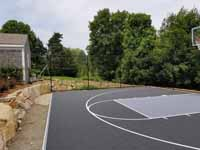 Charcoal and titanium Cape Cod backyard basketball court in Barnstable village of Marstons Mills, MA. Comparative view to previous before picture.